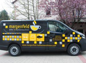 """Seitenansicht des """"margenfeld"""" Fahrzeuges in gelb und grau"""